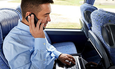 Business Man On Phone Utilizing Transportation Companies